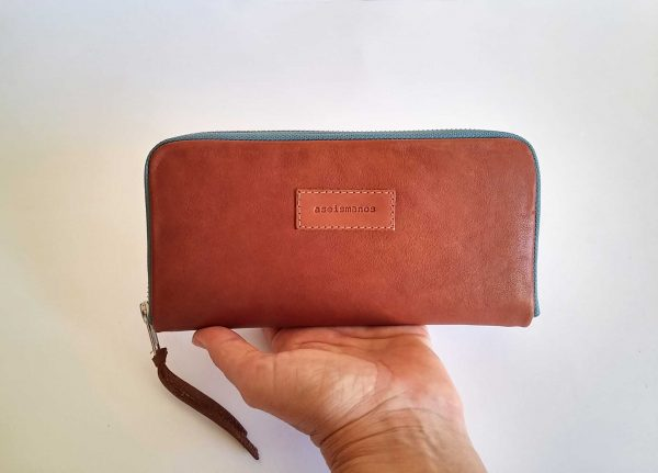 tan leather wallet on hand