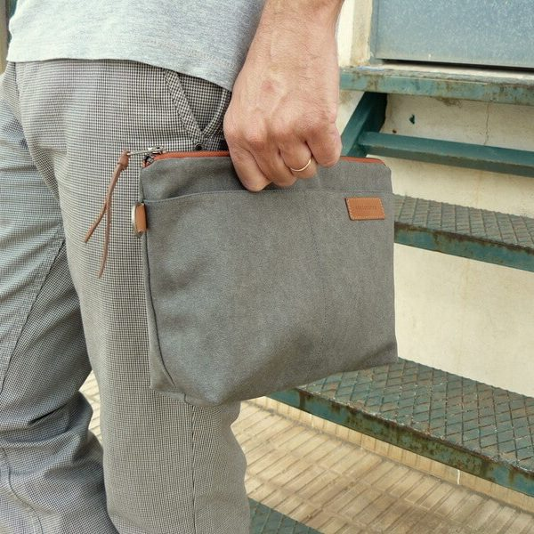 Grey pouch in hand
