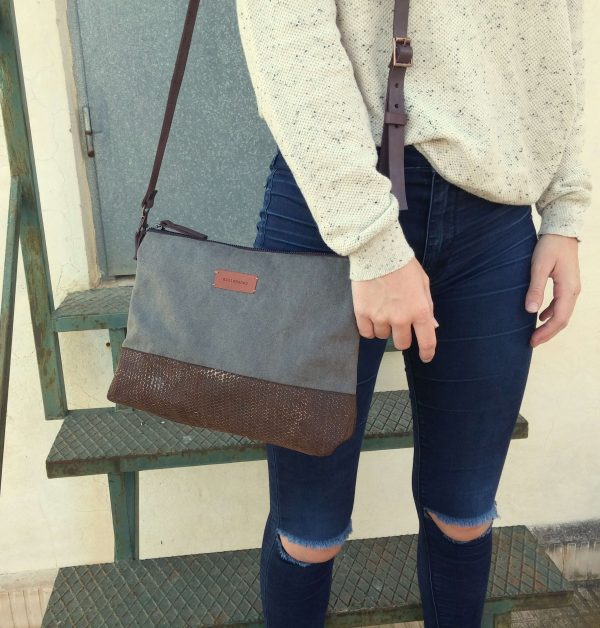 Crossbody day bag grey waxed canvas hanging on shoulder