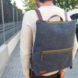 Large backpack worn by man