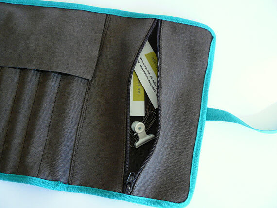 Pencil roll up case showing zip pocket