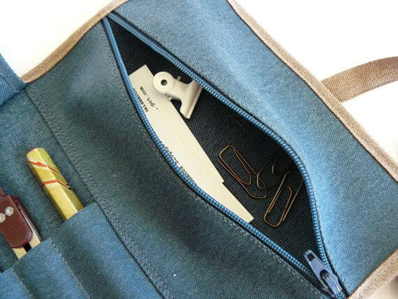 Rollup blue waxed canvasshowing zip pocket