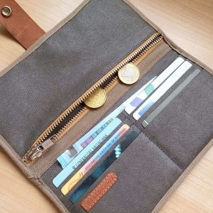 gray bifold wallet with money