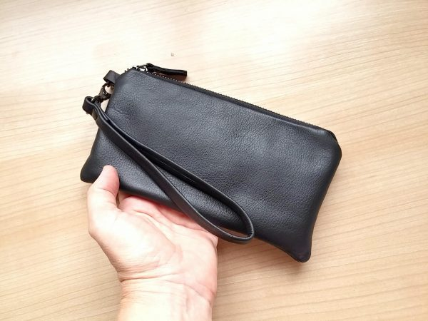 Black leather clutch with wristlet 3 on table