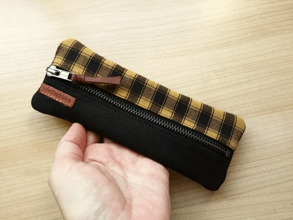 pencil case held in hand