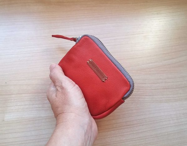 women's leather coin purse held in hand