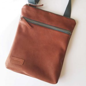Men's leather flat crossbody bag close view