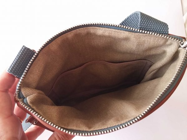 Men's leather flat crossbody bag interior of the bag