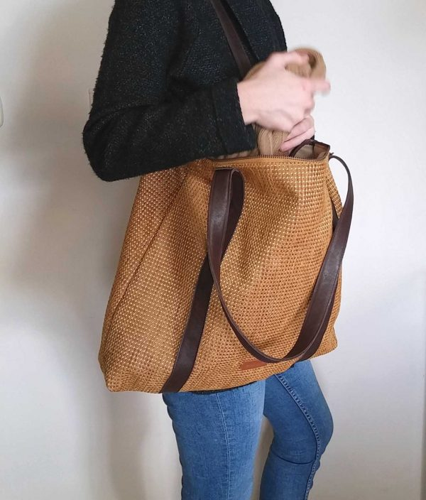 tote hung on a shoulder