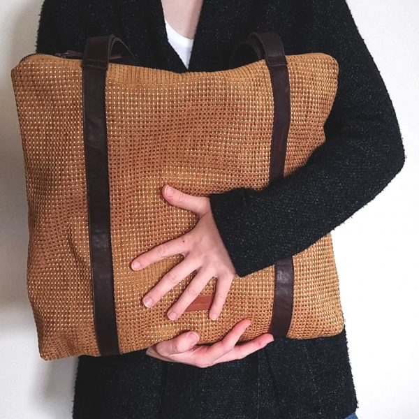mustard tote bag held in hands