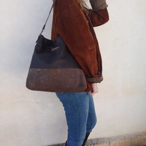 aseismanos leather hobo bag on shoulder