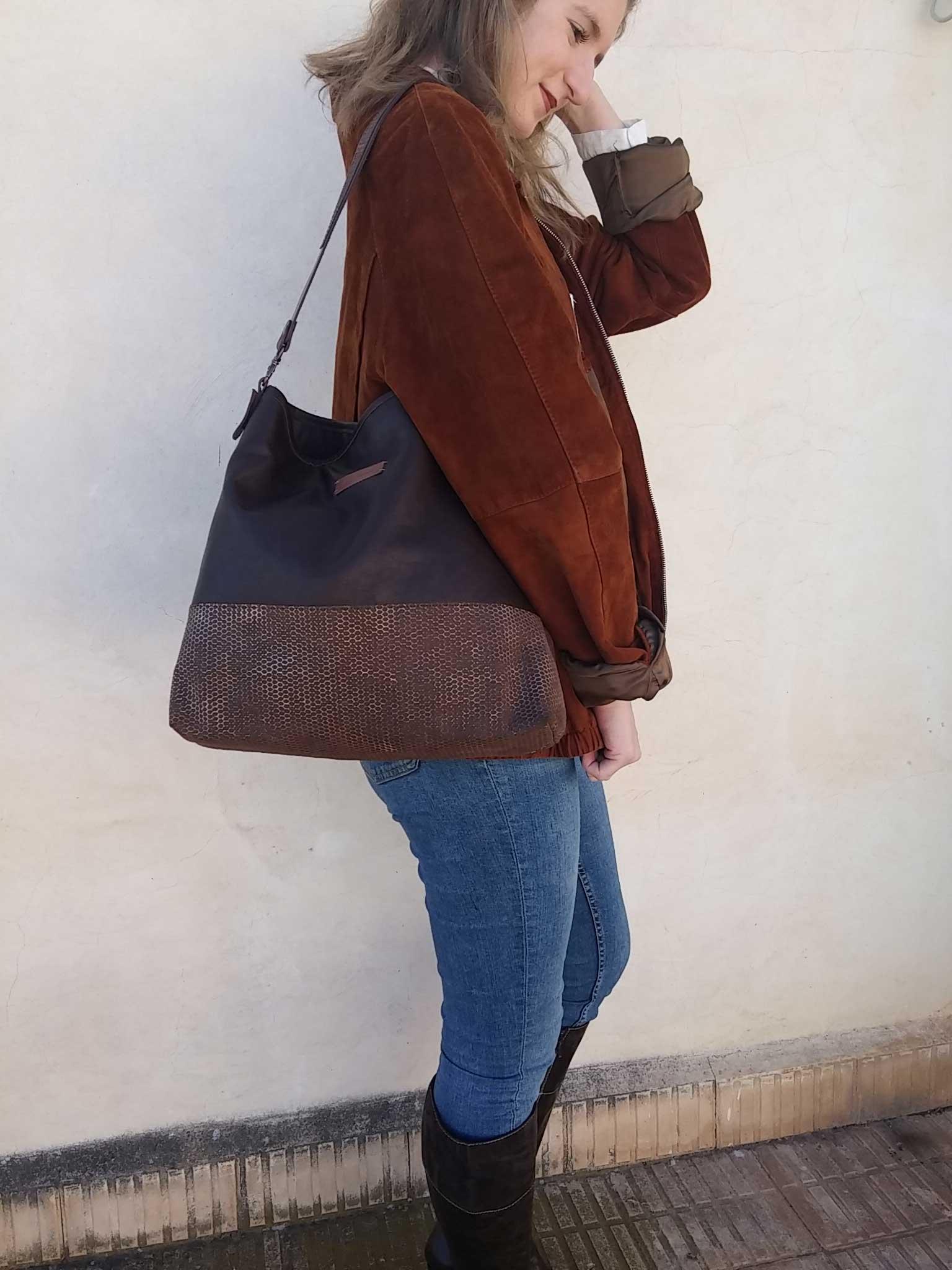 aseismanos leather hobo bag on shoulder