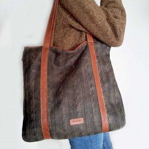 waxed wool tote bag held on shoulder