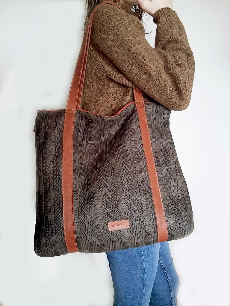 waxed wool tote bag held on shoulder
