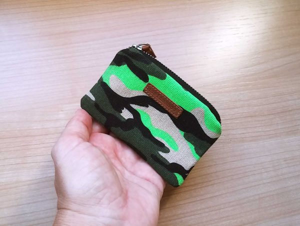 green camo wallet held in hand