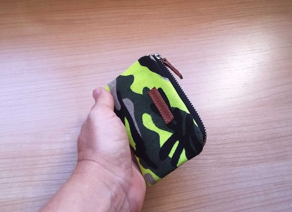 yelow camo wallet held in hand
