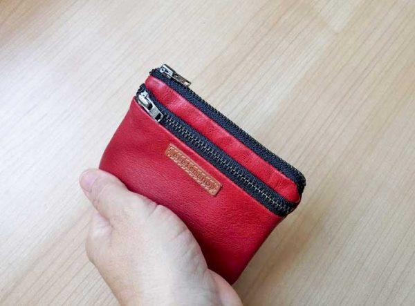 red wallet held in hand