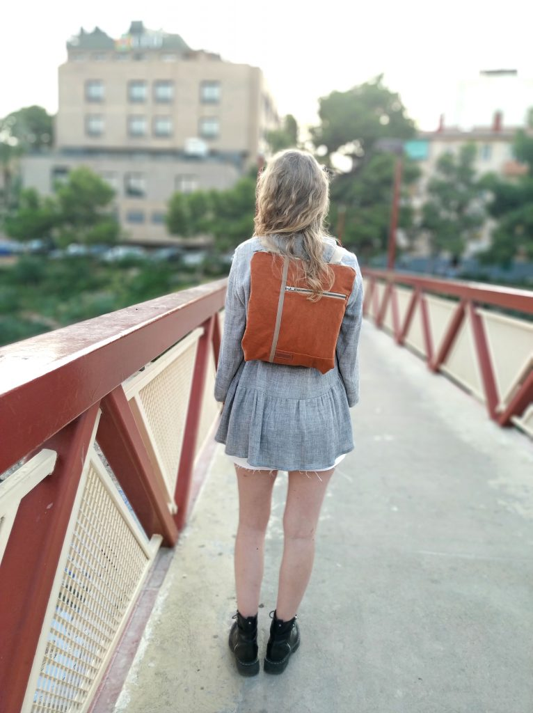 wearing the bag as a backpack