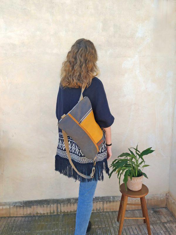 Convertible backpack hanging on one shoulder
