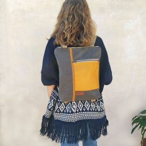 Mustard convertible backpack being worn
