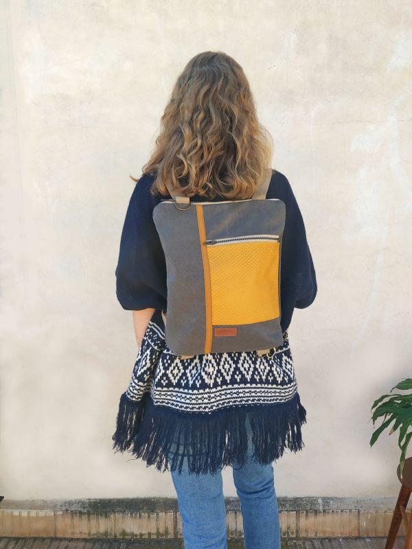 Mustard convertible backpack being worn