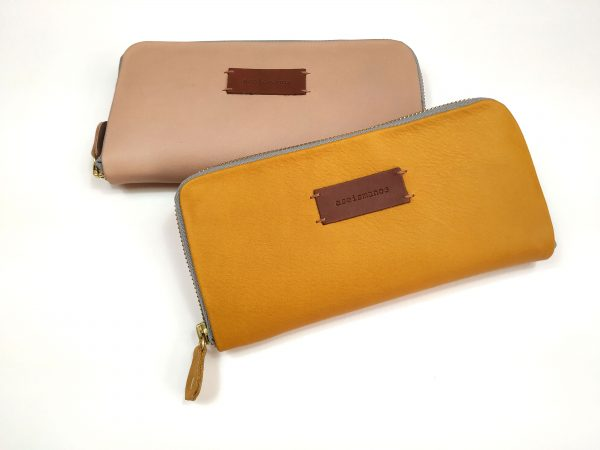 showing mustard and nude wallets