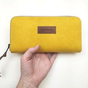 yellow aseismanos wallet held in hand