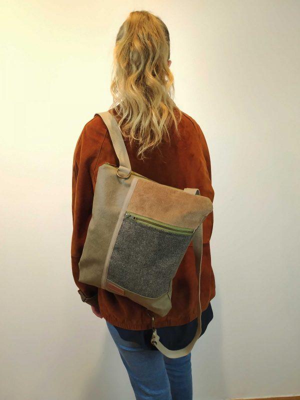 backpack hanging from one shoulder
