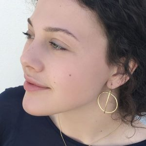 Earrings worn by girl to show size