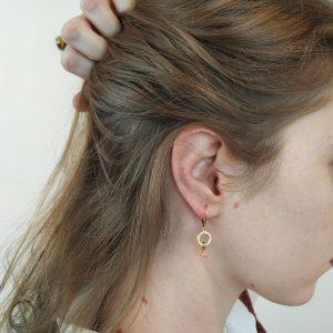 wearing the earrings