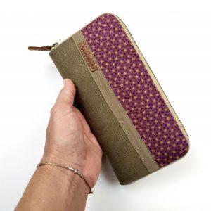 purple aseismanos wallet held in hand